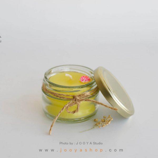 شمع شیشهای کوچک زرد
