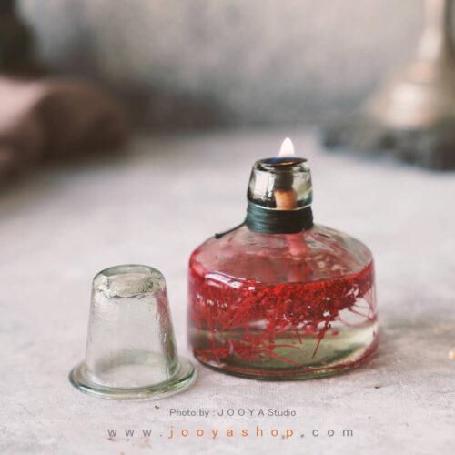 شمع شیشهای گل جیز زرشکی