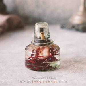 شمع شیشهای گل قرمز