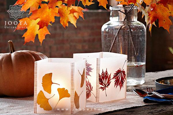 استفاده از برگهای پاییزی و بافتنی برای تزئین شمع